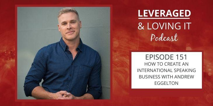 Leveraged and Loving It Episode 151 Andrew Eggelton. A man in a blue shirt with the sleeves rolled up and the first button undone leans against a wall and smiles with lips closed. He is looking at the camera.